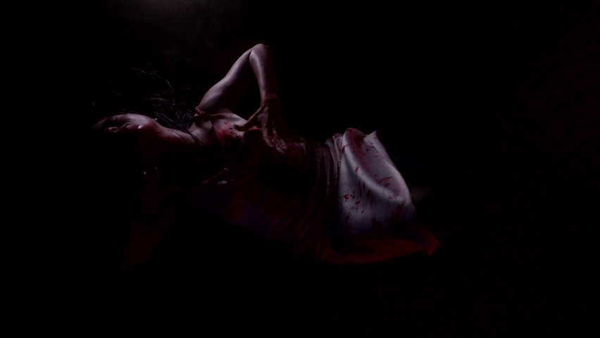 possessed by demon and devil incarnate woman is wriggling in darkness, flickering light Royalty-Free Stock Footage #1071250117