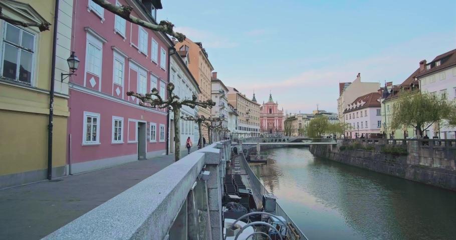 River Ljubljanica Flowing Through old city Ljubljana center - Slovenia Royalty-Free Stock Footage #1071320392