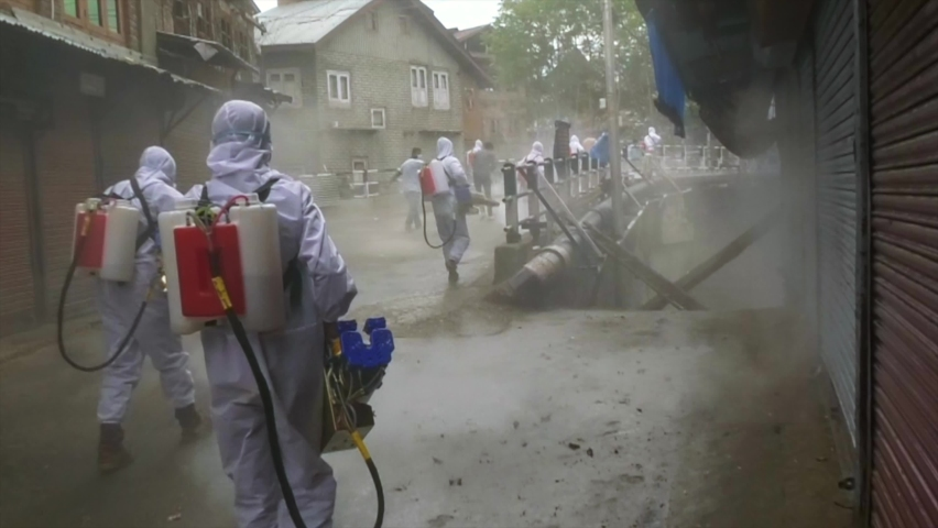 Men fumigation Frontline workers wearing white dress helping societies people to come out from covid-19 2nd phase Royalty-Free Stock Footage #1071368155