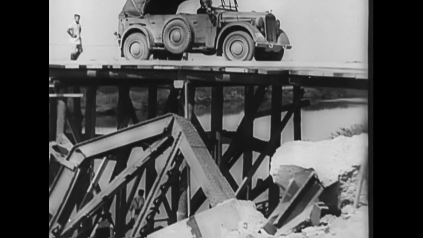 CIRCA 1930s - The Nazi army builds a bridge from ruins to be able to cross a river by carriage, horse and automobiles in Poland in 1939.