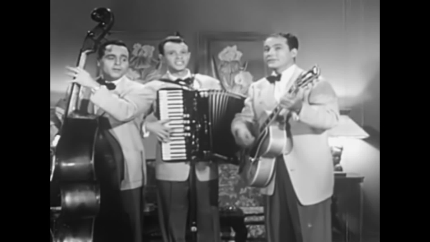 CIRCA 1950s - A folk trio play old standards in this 1950s soundie musical.