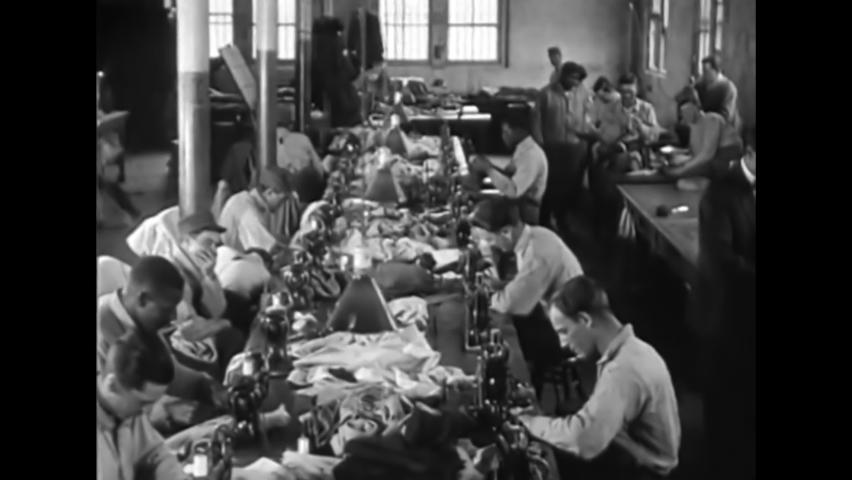 CIRCA 1919 - Prisoners make shoes at Leavenworth Penitentiary in Kansas.