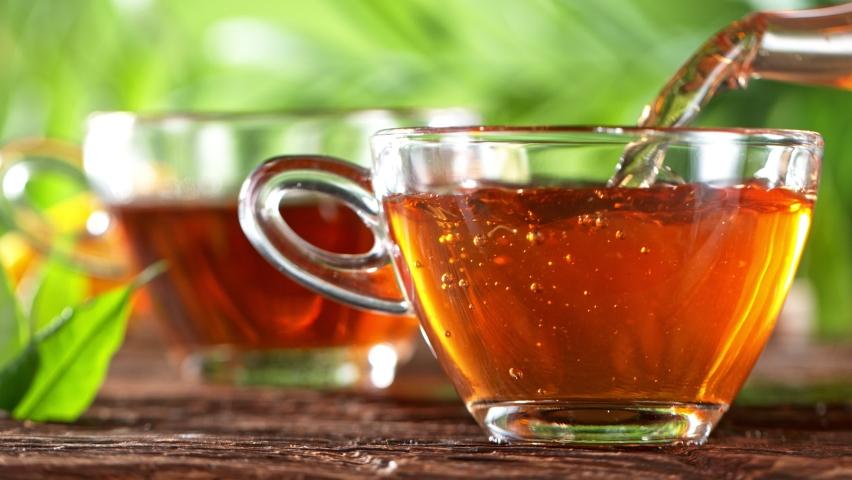 Super Slow Motion Shot of Pouring Tea | Shutterstock HD Video #1071882025