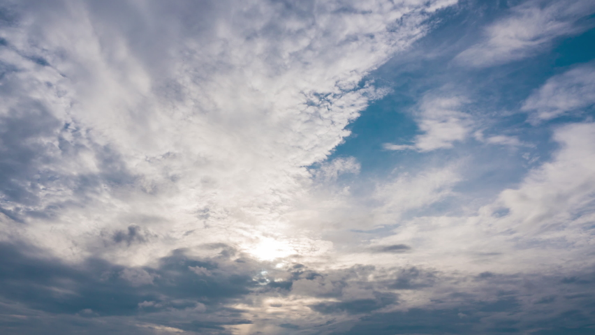 Blue sky white Puffy fluffy Cumulus clouds nature timelapse. Summer blue sky time lapse. Nature blue copy space background. sunlight shine on clouds. Cloud time lapse nature background 4K footage.