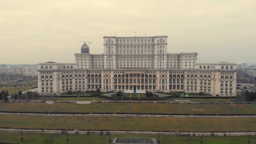 Aerial Cinematic footage clip: Drone flying over The Palace of the Parliament, Unirii Boulevard and Constitutiei square in Bucharest, Romania. the second largest building, built built by Ceausescu | Shutterstock HD Video #1071912637