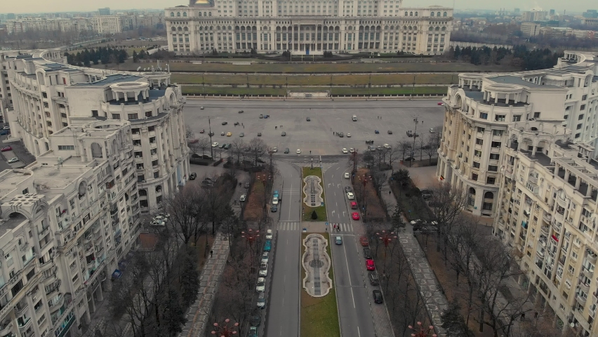Aerial Cinematic footage clip: Drone flying over The Palace of the Parliament, Unirii Boulevard and Constitutiei square in Bucharest, Romania. the second largest building, built built by Ceausescu | Shutterstock HD Video #1071912640