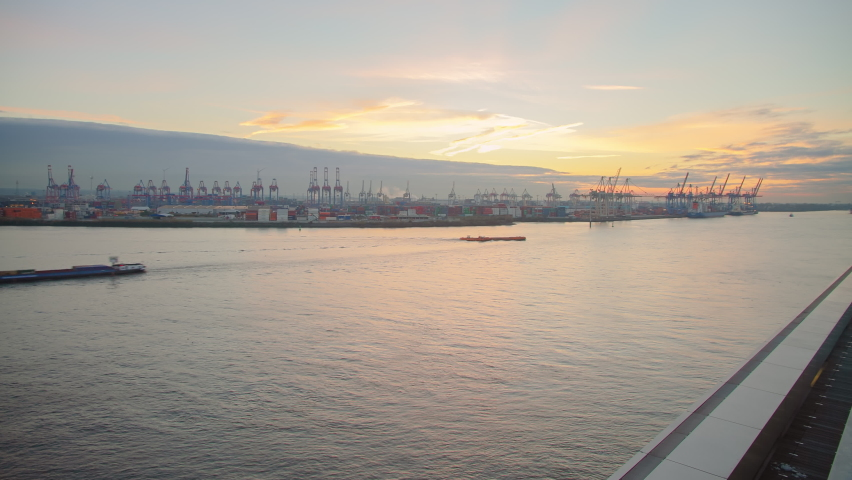extraordinary time lapse shot of the Port of Hamburg with an aircraft carrier approaching at sunset part 1
