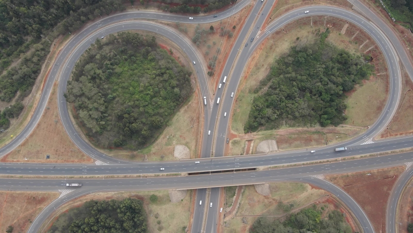 Top view traffic on cloverleaf interchange of Nairobi Southern Bypass Highway   Shutterstock HD Video #1071968056