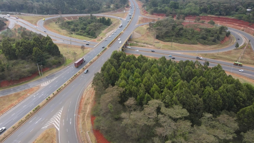 Highway exit on cloverleaf interchange on Nairobi Bypass Kenya, aerial   Shutterstock HD Video #1071968752
