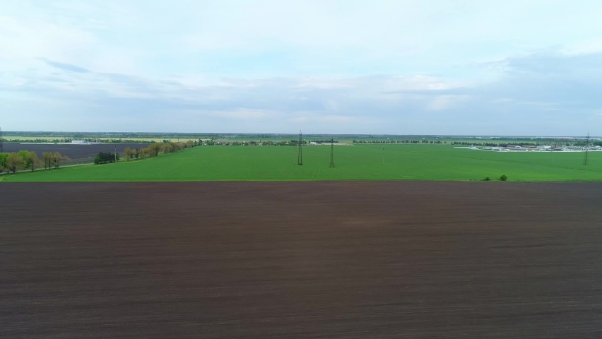 Aerial panorama of arable land, green meadow and agricultural land | Shutterstock HD Video #1072034200