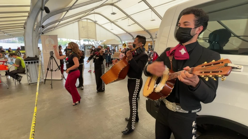 Mariachi Serenade performs at a Covid-19 vaccination center held by CHIRLA, the Coalition for Humane Immigrant Rights, and the Mexican Consulate, in Los Angeles, May 8, 2021.