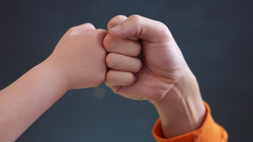 teamwork business concept. fist to fist commit solidarity a respect and brotherhood gesture. business kid team hands fists. happy family partnership friendship close-up teamwork. father and daughter Royalty-Free Stock Footage #1072107503