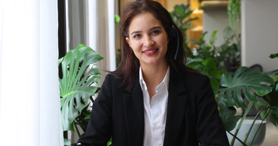 Attractive business woman Asian in suits and headsets are smiling while working with computer at office. Customer service assistant working in office. VOIP Helpdesk headset | Shutterstock HD Video #1072143803