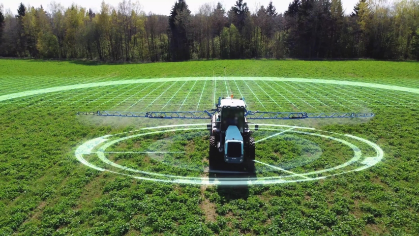 Aerial view of autonomous self-driving tractor with autopilot spraying mineral, nitrogen fertilizer or pesticides on an agricultural field. The agricultural vehicle uses sensors and a GPS signal. Royalty-Free Stock Footage #1072363775
