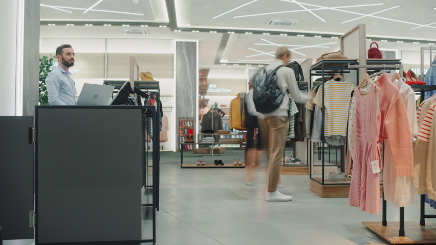 Time-Lapse in Clothing Store. Diverse Group of Costumers bying Clothes and Merchandise at Checkout Cashier Counter. Retail Fashion Shop Assistant Services Clients, Selling Designer Brands to People Royalty-Free Stock Footage #1072389944