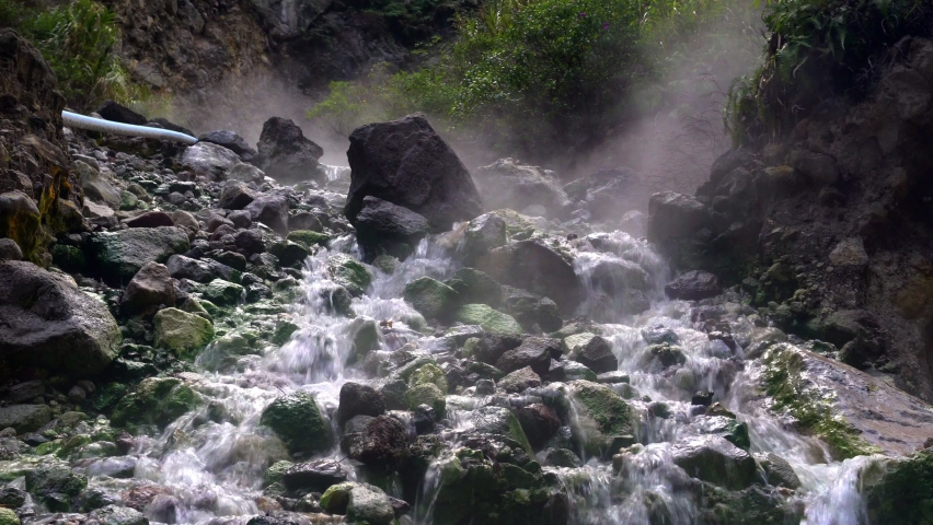 Activity of natural volcanic sulfuric hot springs, clouds of hot gas, steam. Sulfuric hot springs on the islands of the Philippines. Royalty-Free Stock Footage #1072433915