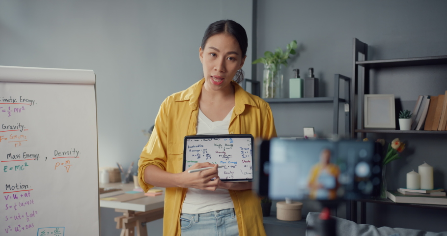 Young Asia lady teacher video conference calling on smartphone talk by webcam learn teach in online chat at home. Remote school classroom, Social distancing, quarantine for corona virus prevention. Royalty-Free Stock Footage #1072455902