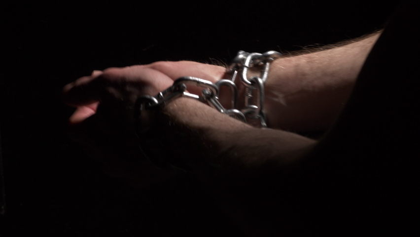 Conceptual shot of hands breaking loose from chains Royalty-Free Stock Footage #1072586318