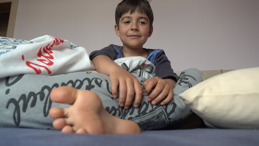 4K Ticklish boy in bed does not let tickle his soles ....,,.
