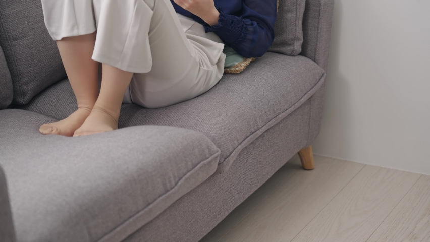 Young asian woman reading a book in the room. Royalty-Free Stock Footage #1072646048