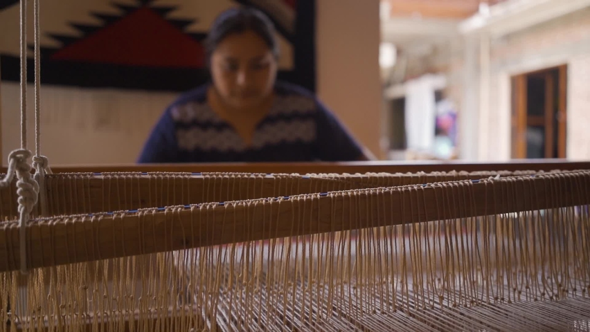 Mexican artisan jobs. woman using a hand weaving loom to elaborate traditional fabric.  Royalty-Free Stock Footage #1072708859