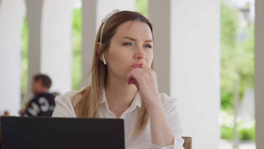 Portrait of serious focused woman search for inspiration to make decision. Thoughtful concerned woman working on laptop computer looking away thinking solving problem at outdoor office. RED HELIUM 8K Royalty-Free Stock Footage #1072710935