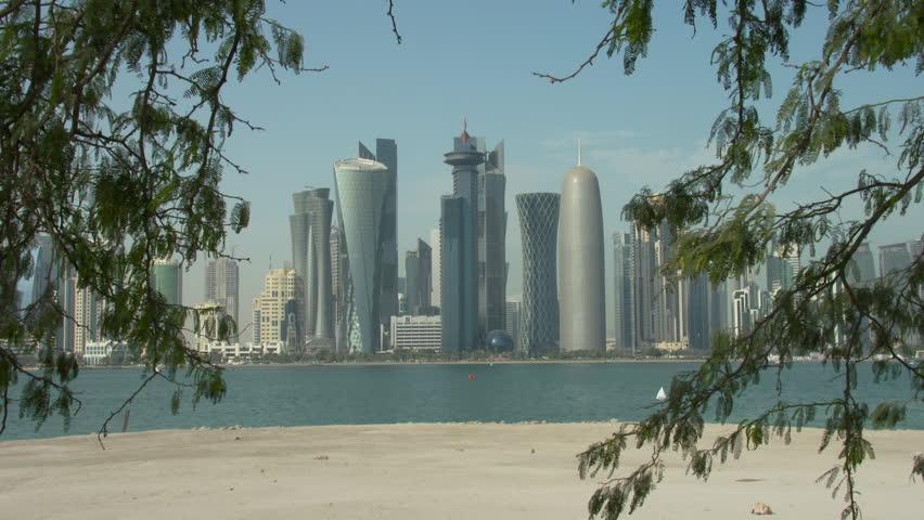 Qatar Doha skyline seen through trees across the bay | Shutterstock HD Video #10727585