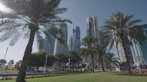 cityscape Doha Qatar wide view through palm trees