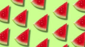 Contemporary minimal motion art. Pattern of a watermelon on a green pastel colour background.