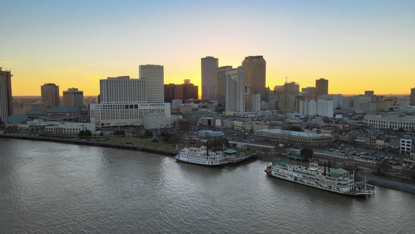 New Orleans Louisiana Mississippi River Aerial Shot at Sunset Skyline of Big Easy with Ferrys