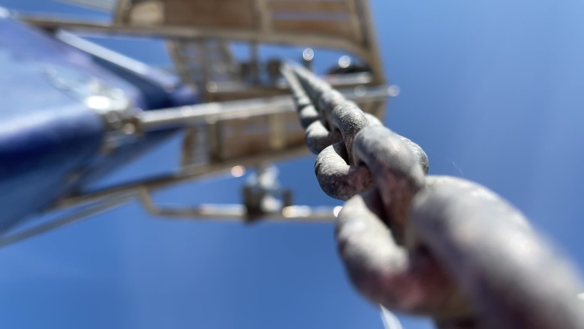 Movement along anchor chain at bow of blue yacht   Shutterstock HD Video #1072876397