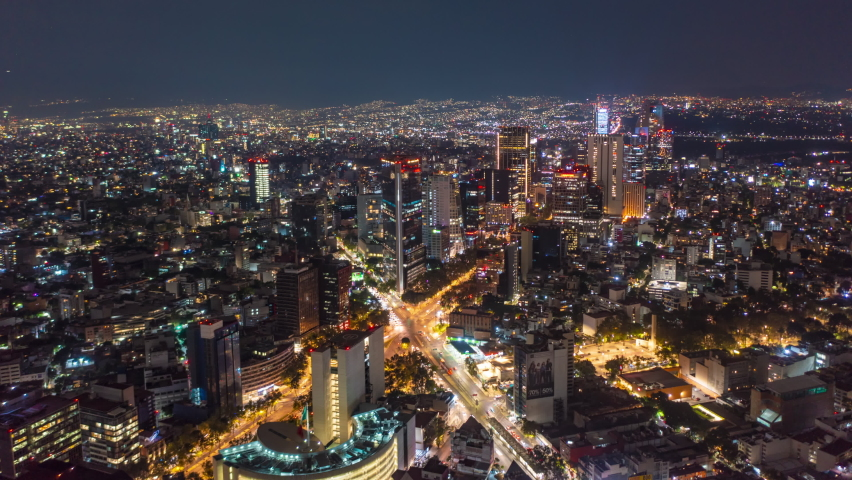 Beautiful Aerial Drone Hyperlapse view of urban modern Mexico City center with tall skyscrapers and flashing City lights at night, Hyper Lapse of City movement