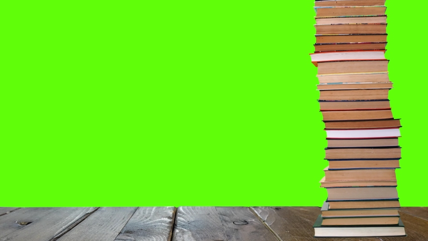 A pile of books growing on a green background. Royalty-Free Stock Footage #1073153039