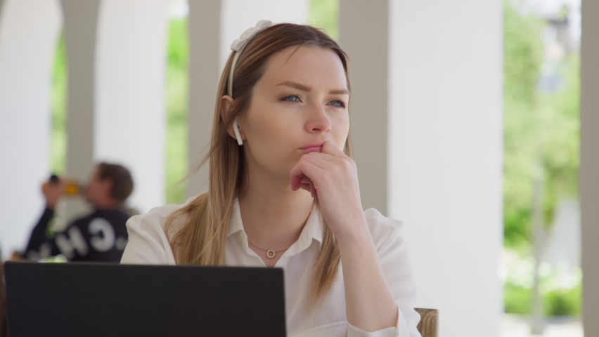 Portrait of serious focused woman search for inspiration to make decision. Thoughtful concerned woman working on laptop computer looking away thinking solving problem at outdoor office. RED HELIUM 8K Royalty-Free Stock Footage #1073338400