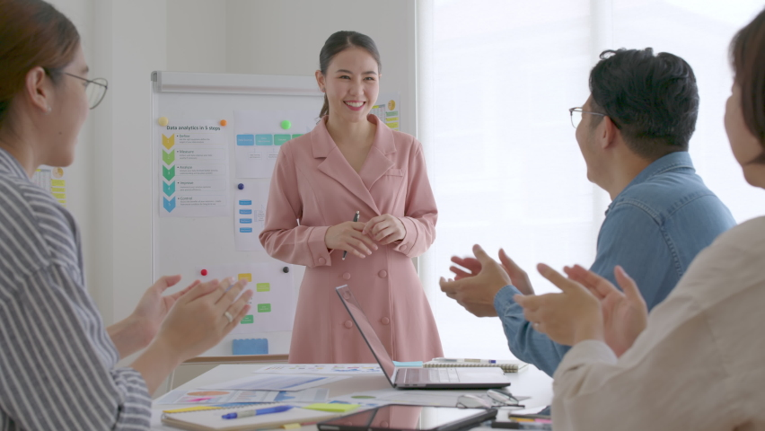 Small group asia female young happy people, sale team work in reskill upskill training class share plan idea in project research job feel bonding thankful respect greeting smile stand in office room. Royalty-Free Stock Footage #1073339108