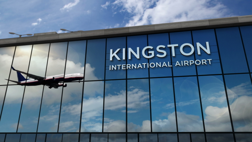 Jet aircraft landing at Kingston, Jamaica 3D rendering animation. Arrival in the city with the glass airport terminal and reflection of the plane. Travel, business, tourism and transport concept.   Shutterstock HD Video #1073563850