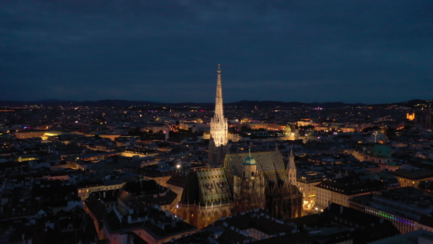 twilight night illumination vienna city famous cathedral central district aerial panorama 4k austria Royalty-Free Stock Footage #1073728811