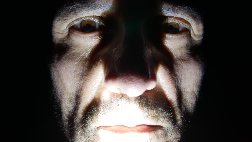 Scary ugly man face marked by wrinkles close up at night with light and shadow, horror character with crazy eyes and red lips   Shutterstock HD Video #1073781899