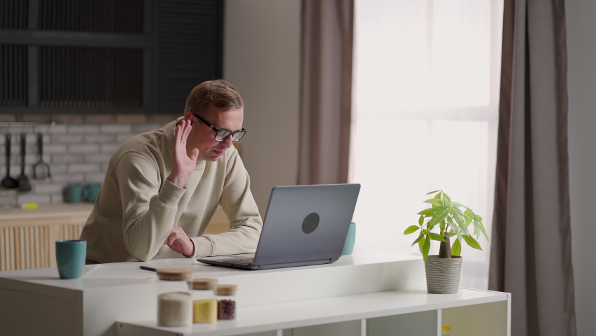 Young businessman conference calling by webcam, student study with online teacher in video chat look at laptop talk during videoconference at home office