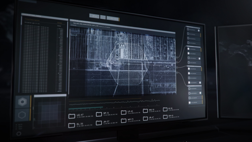 Computer Monitors. Newest Spying Software. The Spy is Investigating the Fielded Areas. Spying System has found the Location of the Enemy Army bases. Huge amount of Tanks on the Ground. User Interface. | Shutterstock HD Video #1073961749