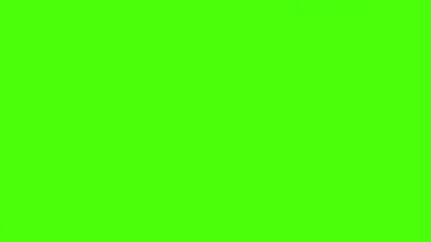 Young businessman in  a gray suit writing something on his diary against a green screen #1074013