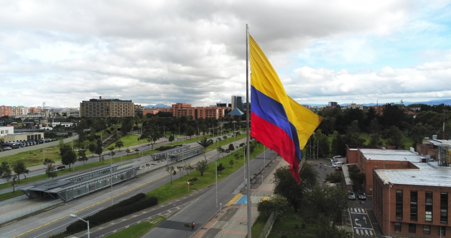 Drone view of giant Colombian flag in Bogota, Colombia, wide angle spinning shot Royalty-Free Stock Footage #1074081923