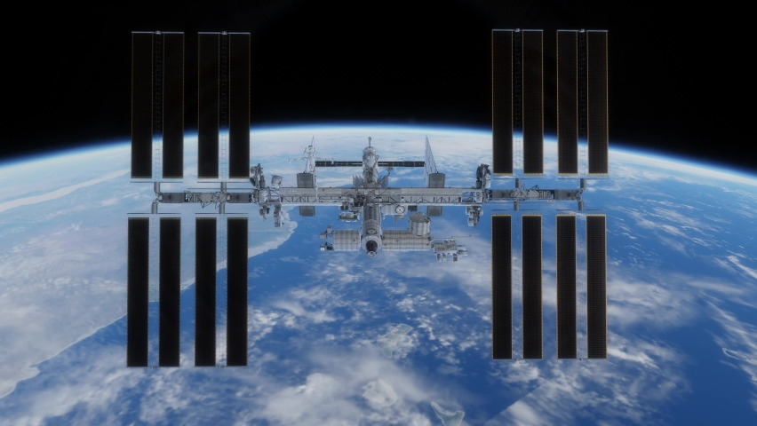 An animation of the International Space Station orbiting above the planet Earth, with swirling clouds, ocean and land below   Shutterstock HD Video #1074082139