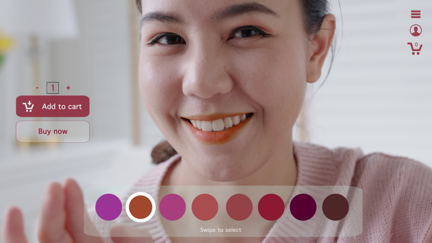 POV asia young teen girl relax happy smile enjoy buy home apply lips makeup ai ar vr mixed augmented reality e-commerce store future fashion mall app in iot smart touch swipe select color web screen. Royalty-Free Stock Footage #1074126956
