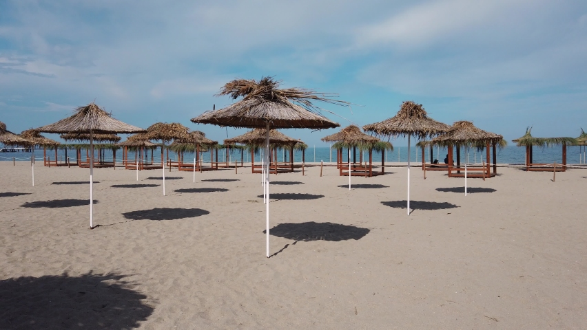 Beach with umbrellas at the Bulgarian Black Sea coast.Burgas Beach.   Shutterstock HD Video #1074161486