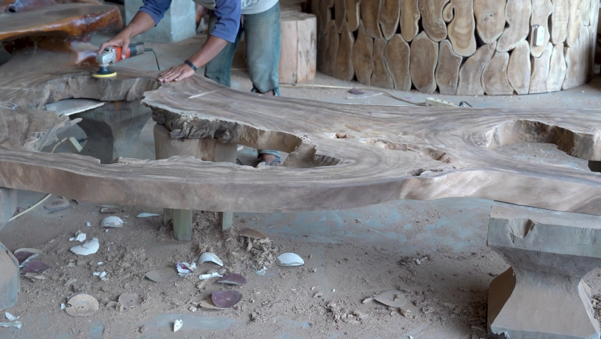 Wooden furniture creating, craftsman in carpenter workshop grinds table top   Shutterstock HD Video #1074382538