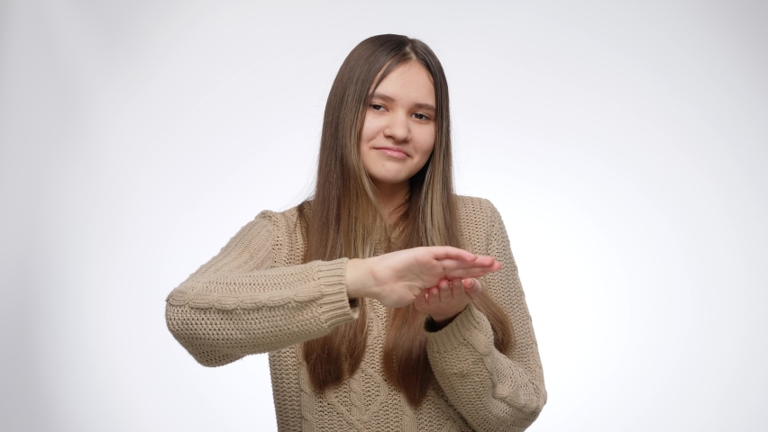 Portrait of successful rich girl making throwing money gesture from hand Royalty-Free Stock Footage #1074585983