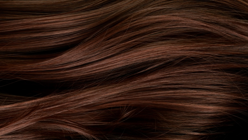 Super slow motion of beautiful healthy long smooth flowing brown hair. Royalty-Free Stock Footage #1074669659