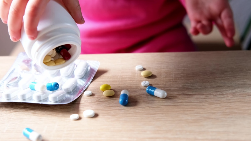 Female hand of a small child, baby, girl playing with medical pills, hazardous to health, drug poisoning concept, poor babysitting   Shutterstock HD Video #1074715829