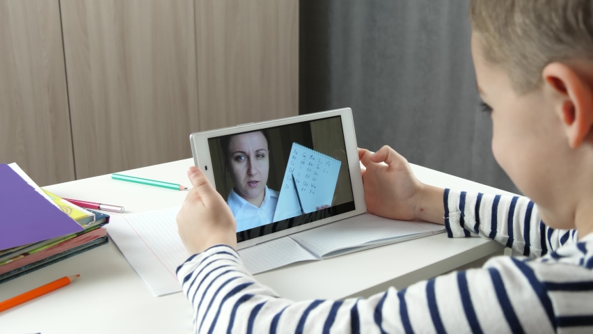 The student and the teacher communicate via video call over the Internet. Online lesson. Remote work. Distance education. Online teacher. Contactless communication during lockdown. | Shutterstock HD Video #1074718319